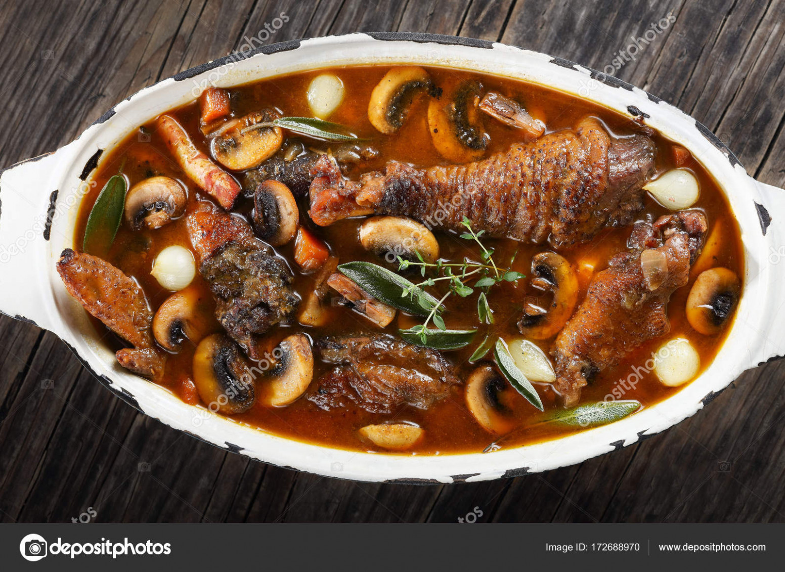 A chicken rooster stewed in red wine — Stock Photo ..