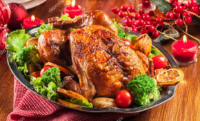 Baked or roasted whole chicken on Christmas table — Stock ...