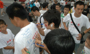 Beijing China , T Shirt Signing At The Watercube – Peace Plus One Climate Change Agents Sign The Shirt Of A GREEN OLYMPICS Supporter  0404 – Healthy Recipes Kids Love