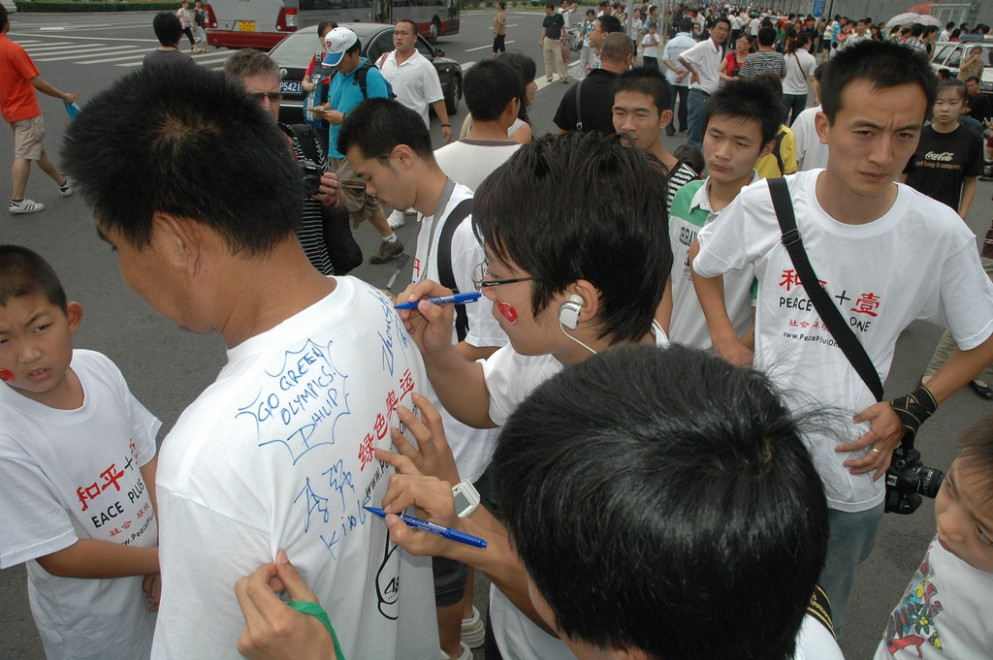 Beijing China , T-Shirt signing at the watercube - Peace Plus One Climate Change Agents sign the shirt of a GREEN OLYMPICS supporter _0404 - healthy recipes kids love