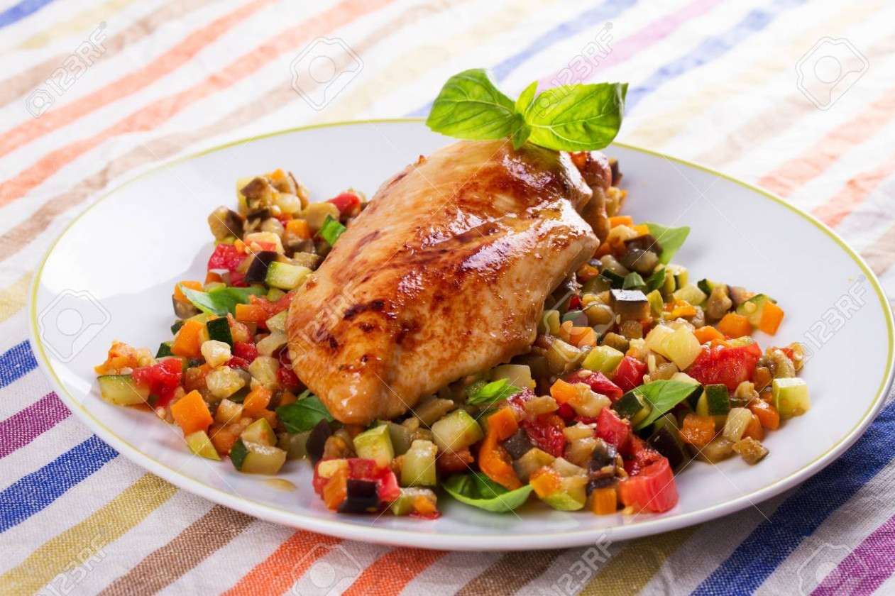 Chicken breast with sauteed vegetables: eggplant, carrot, zucchini,.