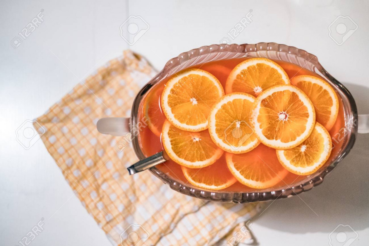 Cocktail juice recipe with orange slices on scott napery in dinner - juicing recipes dinner