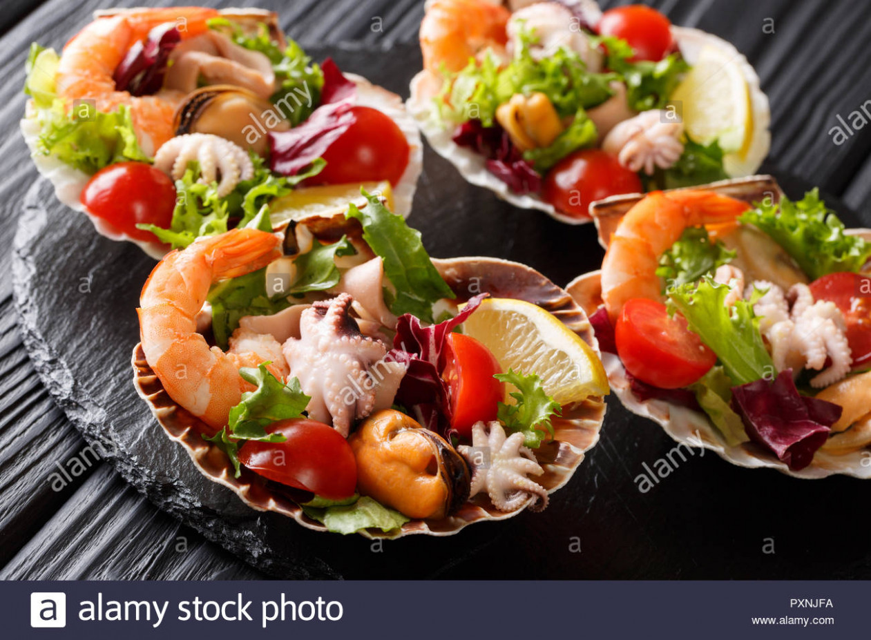 Dietary healthy seafood salad of shrimp, baby octopus ..