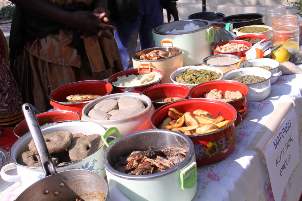 Dishes prepared on site for a food fair held in the Barotse floodplain, Zambia. The food was judged in a competition for the most nutritious dish
