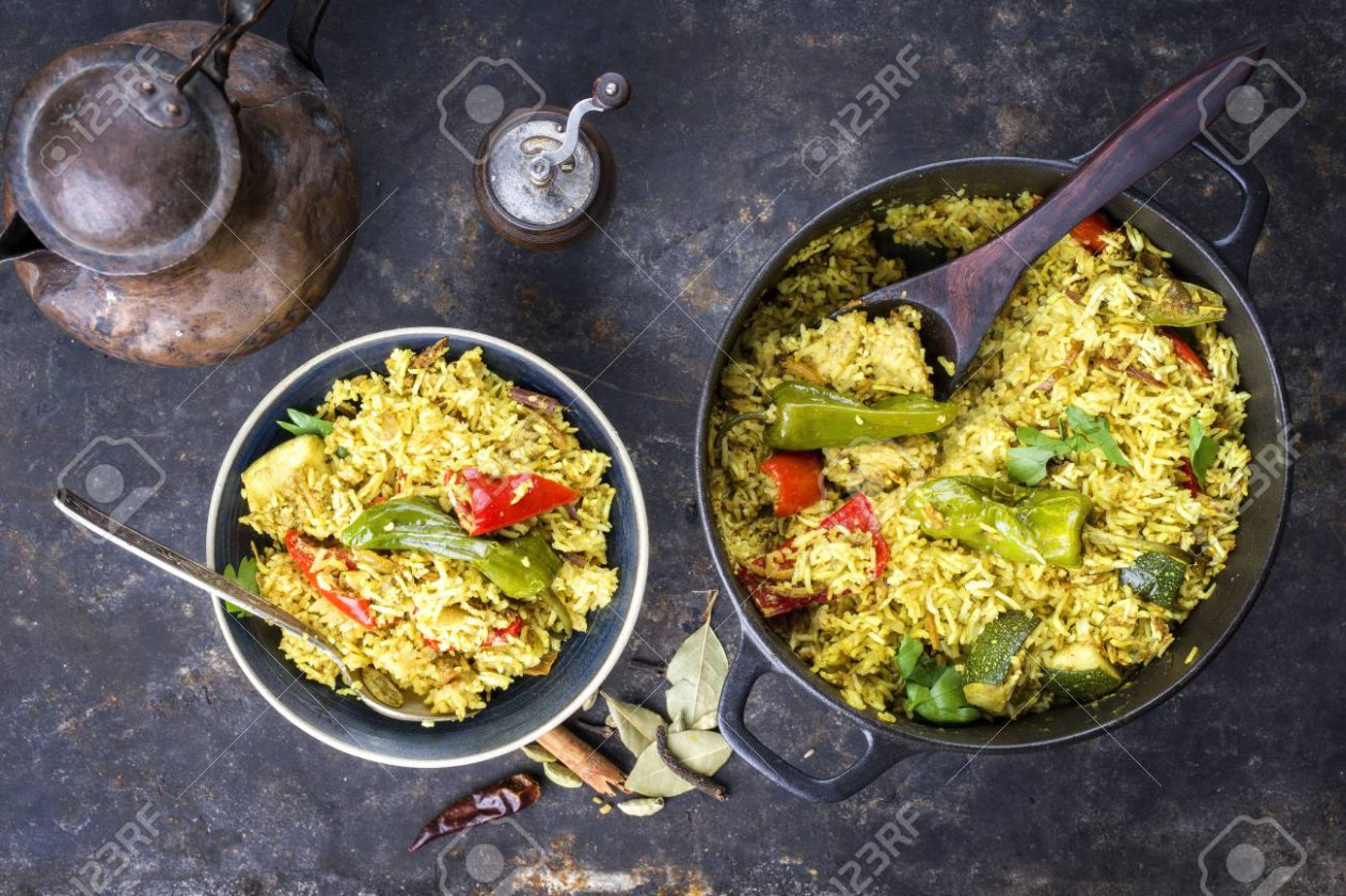 Indian Vegetable Biryani With Sweet Peppers And Zucchini As Close Up.