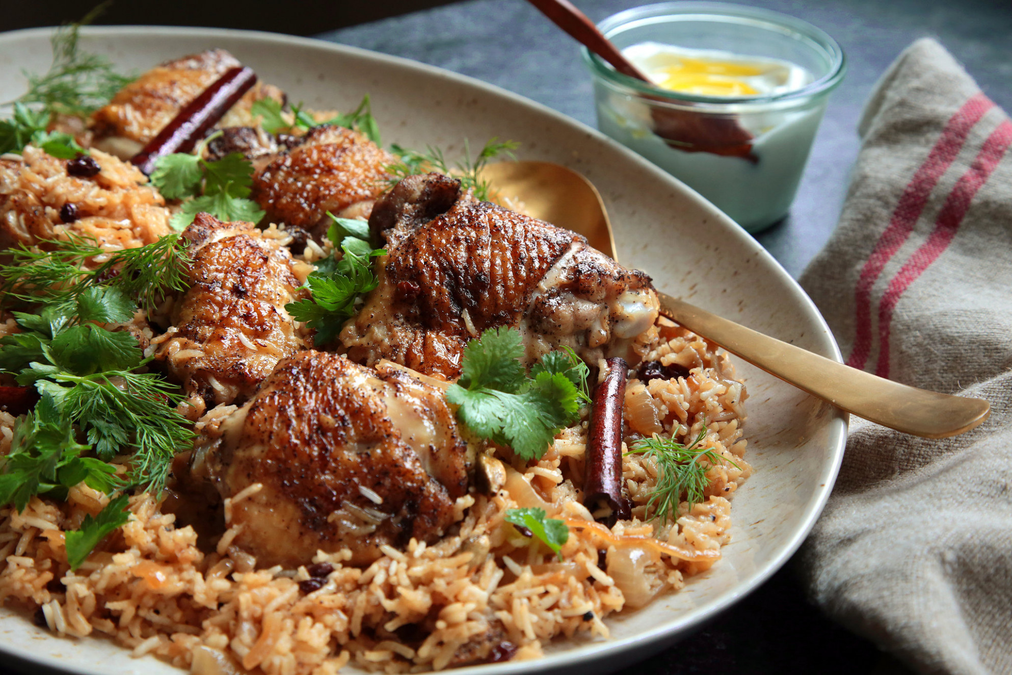 "Julia Moskin cooks chicken with onions and cardamom rice from the cookbook  ""Jerusalem.""CreditCredit.."