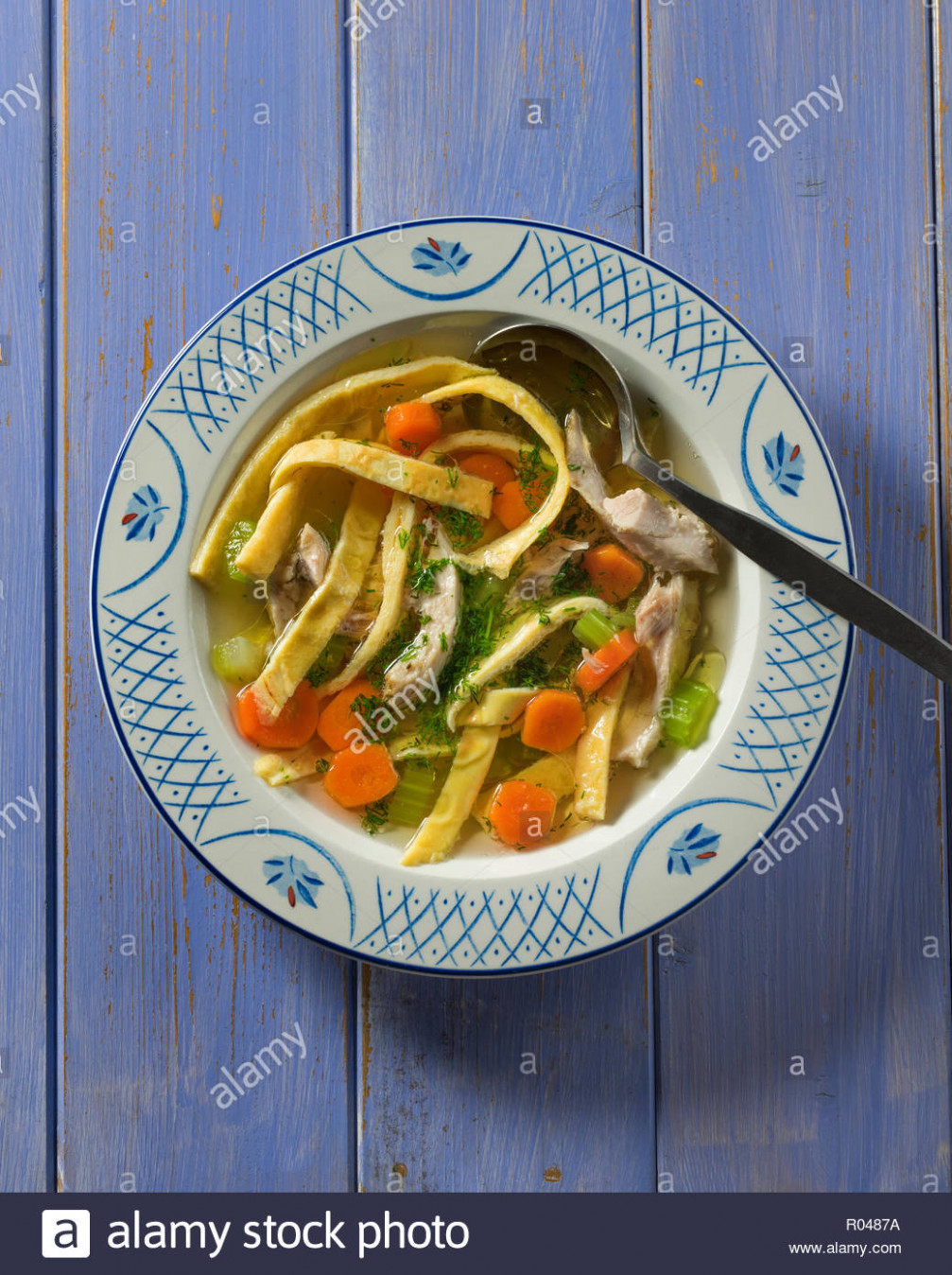 Lokshen soup. Chicken soup with egg noodles. Traditional ..
