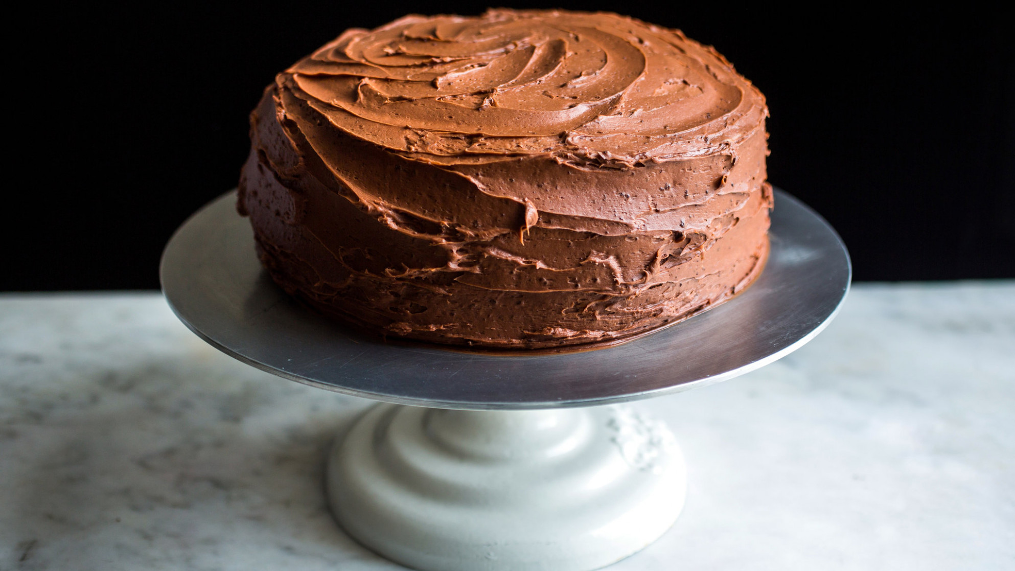 Melissa Clark makes the most devilish of devil's food cakes by using two  types of frosting: black pepper buttercream and chocolate  fudge.CreditCredit..