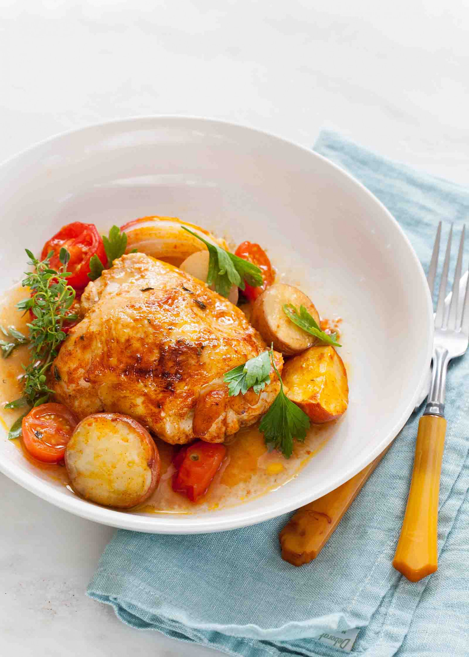 One-Pan Paprika Chicken with Potatoes and Tomatoes Recipe |  SimplyRecipes