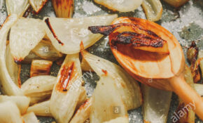 Roasted fennel in a baking pan with olive oil. Tasty ...