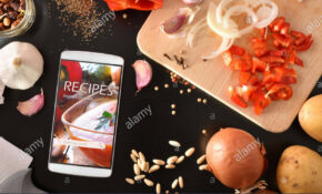 Smartphone With Online Recipes App And Ingredients ..