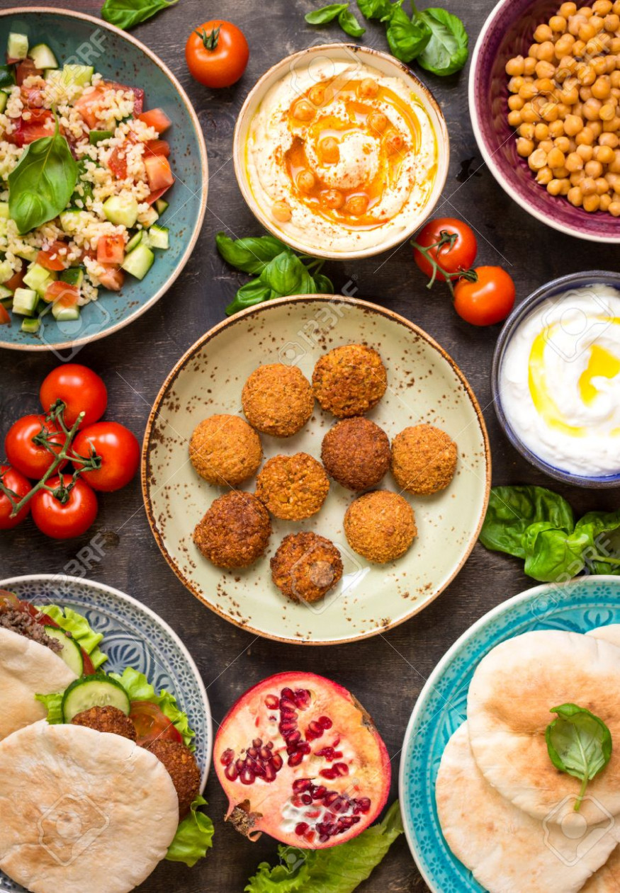 Table Served With Middle Eastern Traditional Dishes. Bowl With.